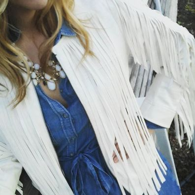 The white jacket pop over this denim dress.